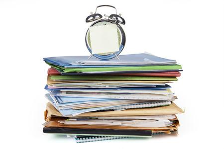 Alarm clock and documents, isolated on white background photo