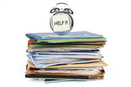 gestion documental: Reloj con alarma y documentos, aislado en fondo blanco Foto de archivo