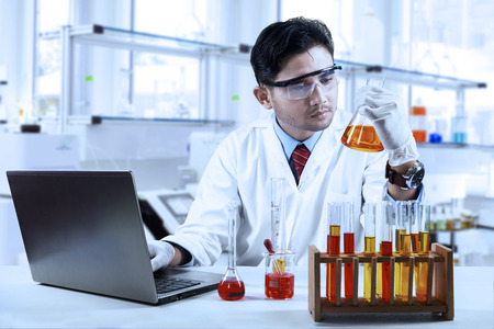 japanese: Asian chemist working in laboratory and doing research