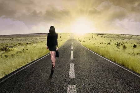 aspirations ideas: Businesswoman standing on the highway road, symbolizing as the way to the new opportunity