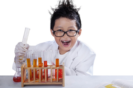 Portrait of little mad scientist doing research, isolated over white background