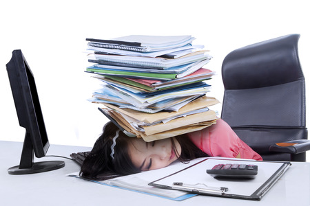 Portrait of asian female accountant with a pile of paperwork over her head photo