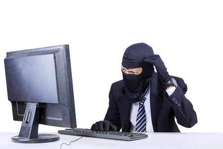 Anonymous hacker wearing a mask getting confused, isolated over white photo