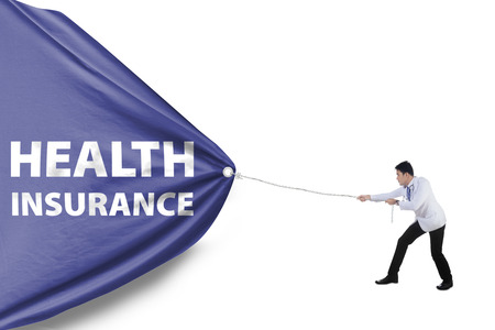 Asian doctor pulling a banner to promote health insurance, isolated over white background Stock Photo