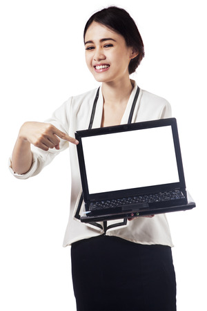Pretty businesswoman presenting empty laptop screen, isolated on white background photo