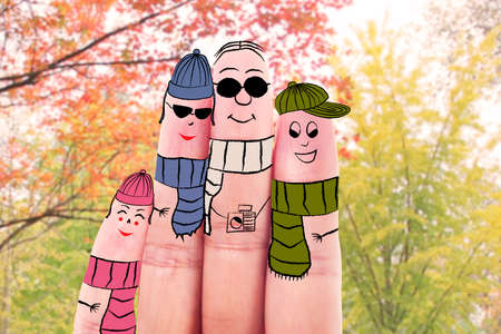 whittle: Fingers gesturing as family members wearing autumn clothes
