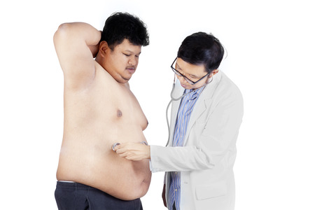 Doctor is checking a fat man. isolated on white background photo