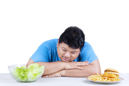 oversize: Starting healthy eating; overweight person rejects junk food