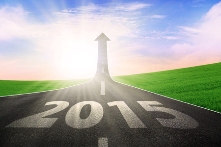vision concept: The long highway with upward arrow to the sky, symbolizing the way to better future 2015 Stock Photo