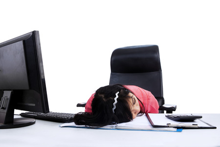 Young asian businesswoman sleeping on the desk photo