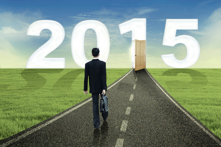 Young business person walking towards the future to success in 2015 photo