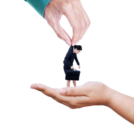 Employee exchange concept with two hands transferring businesswoman photo