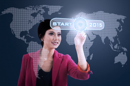 asian business woman: Asian business woman with a business start button to start her business in 2015
