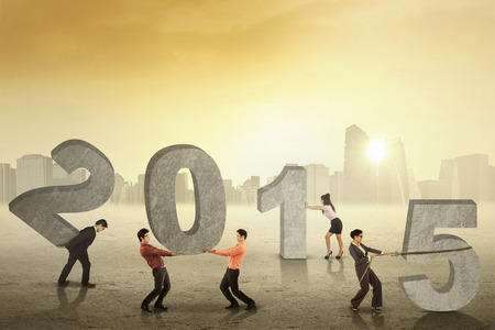 arrange: Group of business people arrange number 2015 outdoors in the morning Stock Photo