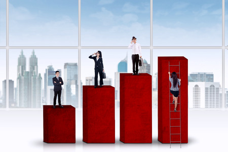 Young businesspeople standing over a business chart photo