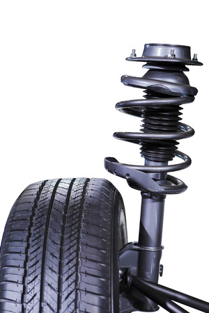 resilient: Black shock absorber and wheel, isolated over white background Stock Photo