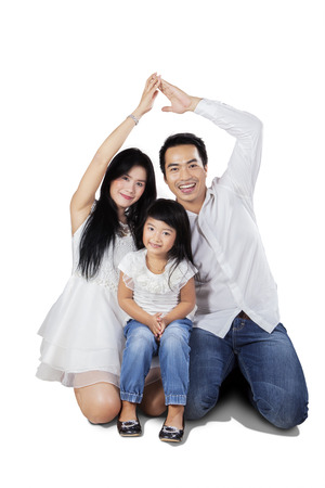 Two parents make protection symbol with their hands, isolated on white background photo