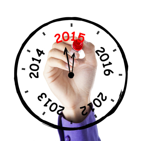 Hand makes annual clock with number 2012, 2013, 2014, 2015, on whiteboard photo