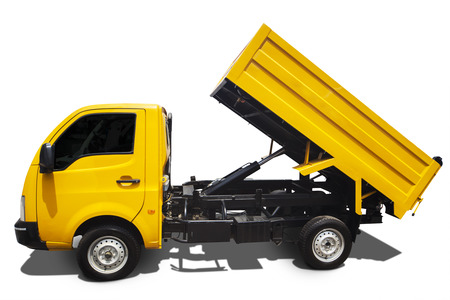 Dump truck with shadow isolated on white background photo