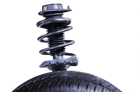 Modern shock absorber, isolated over white background photo