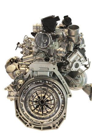 Closeup of modern car engine, isolated over white background photo