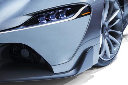sportscar: Closeup of luxury sport car light, shot in car exhibition Stock Photo