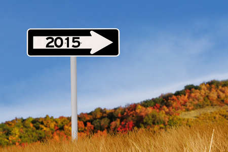 Signpost with number 2015 in autumn under blue sky photo