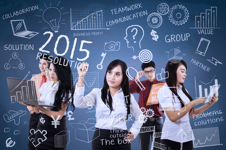 Young business people finding idea for make resolutions in 2015 photo