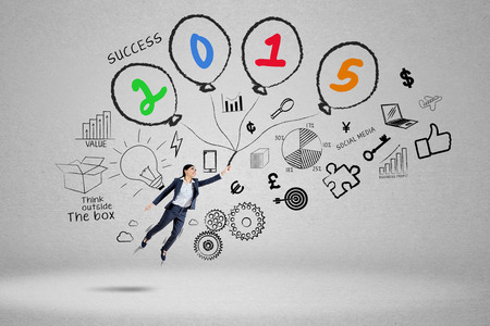 job opportunities: Business person with doodle fly to chase her goal in future 2015 Stock Photo