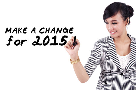 Young asian woman writes a text to make a change in 2015 photo