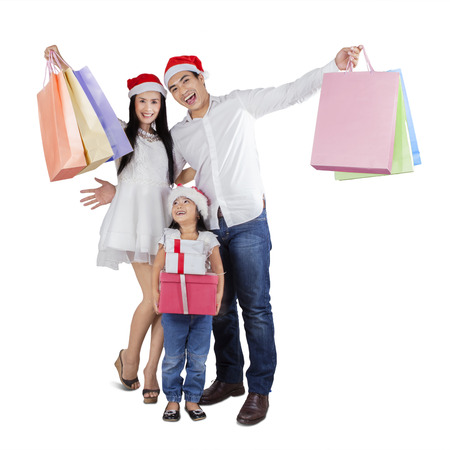 Cheerful family with shopping bags and christmas gift celebrate christmas day photo