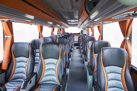 Row of seats inside tourist bus, shot in exhibition