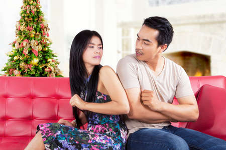 asian wife: Portrait of asian people quarreling at home with christmas tree background