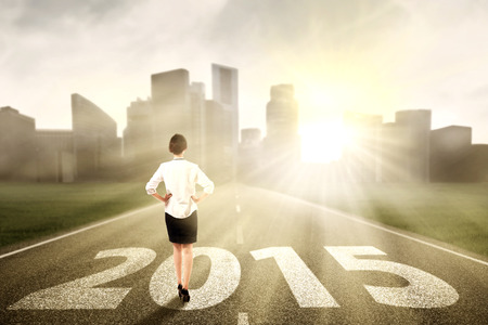 Woman standing on the road looking a chance in the future 2015 photo