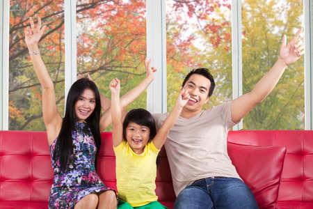Three member of asian family expressing happy to enjoy autumn photo