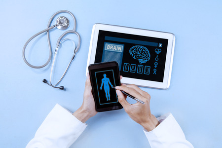 medicines: Closeup of doctor hands using smartphone and digital tablet for diagnosis Stock Photo