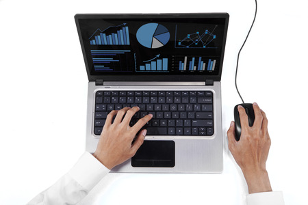 High angle view table of businessman hands using laptop to analyze chart photo
