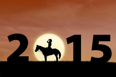 Silhouette of female horse rider at sunset with 2015 outdoor photo
