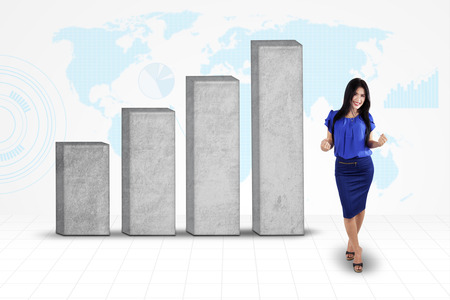 upward graph: Cheerful businesswoman celebrate her success near with business graph in front of global map