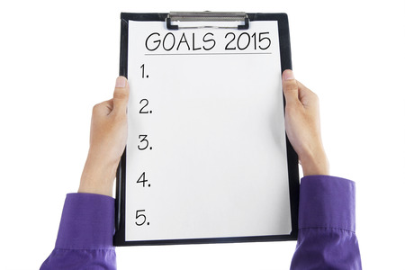 Clipboard with a list to make business goals in 2015 photo