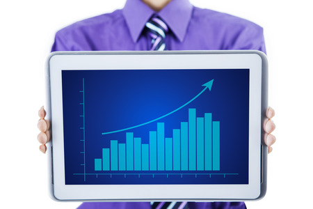 A businessman showing growth graph on digital tablet photo