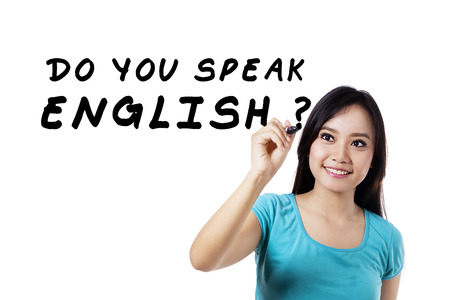 english text: Learning language concept. Female student write Do You Speak English?