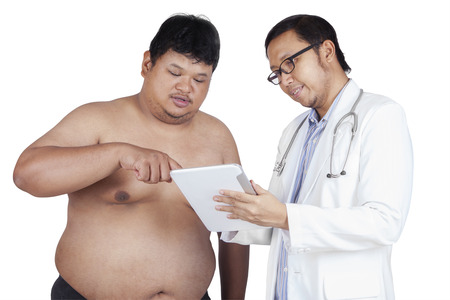 Curious patient look the test result on a digital tablet with his doctor photo