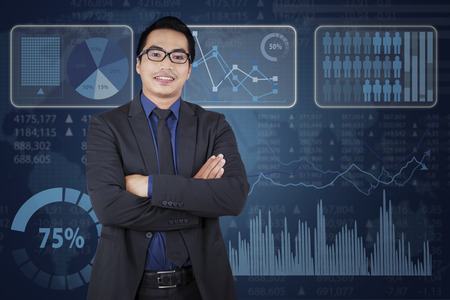 Portrait of asian businessperson smiling on camera confidently in front of business chart photo