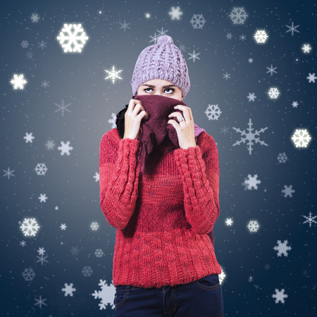 Portrait of a beautiful woman wearing winter clothing on christmas  photo