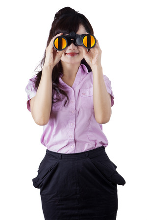 Portrait of asian businessperson using binocular for looking her vision photo