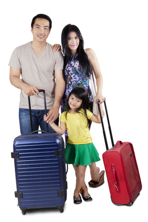 holiday destination: Happy asian family carrying luggage and ready to holiday, isolated over white