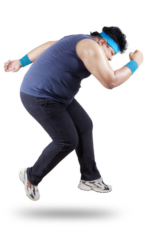 fat man: Fat man running for exercising. isolated on white
