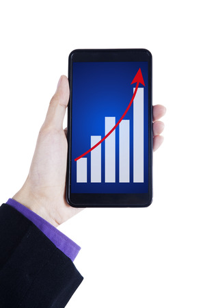 Close up of businessman hands showing growth graph on smartphone photo