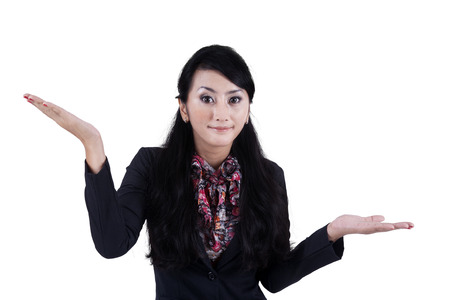 Portrait of a confused businesswoman on white background photo